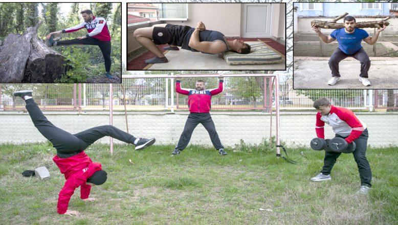 Güreşçiler, evde antrenman yaparak formda kalıyor